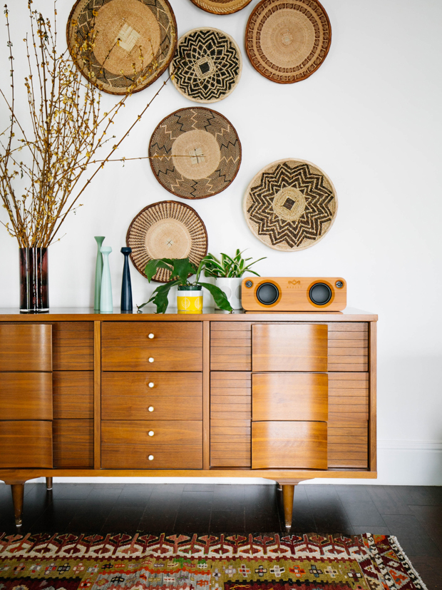 mid century credenza and basket gallery wall